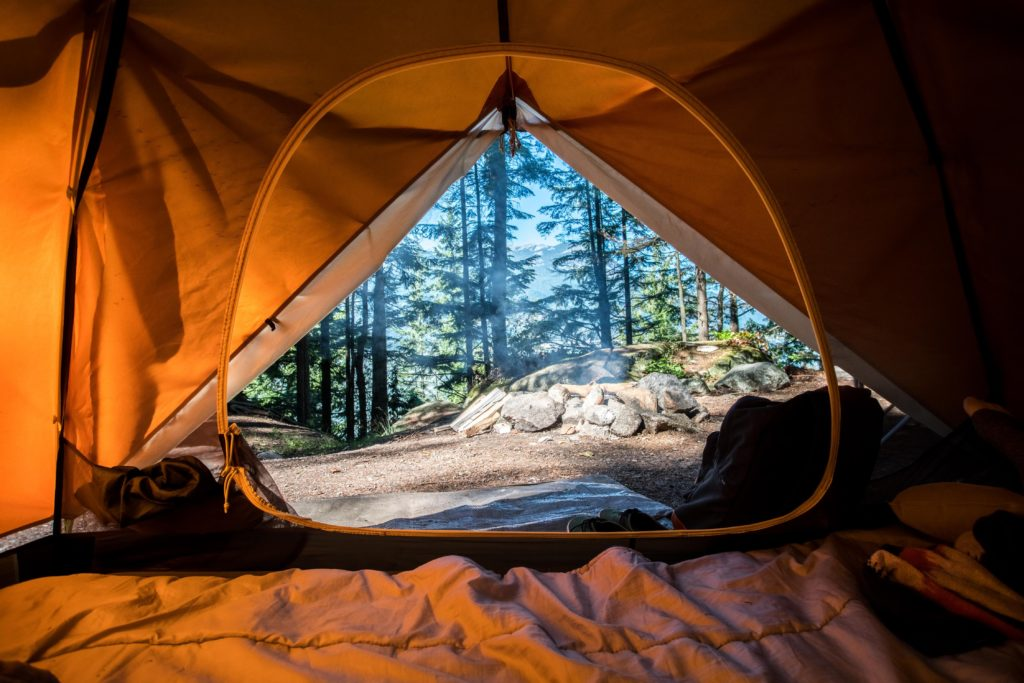 camping relieves stress and builds relationships.Camping tent interior with open tent door